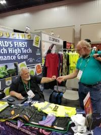 James Saar of ASA helps customer at Renco's booth at 2017